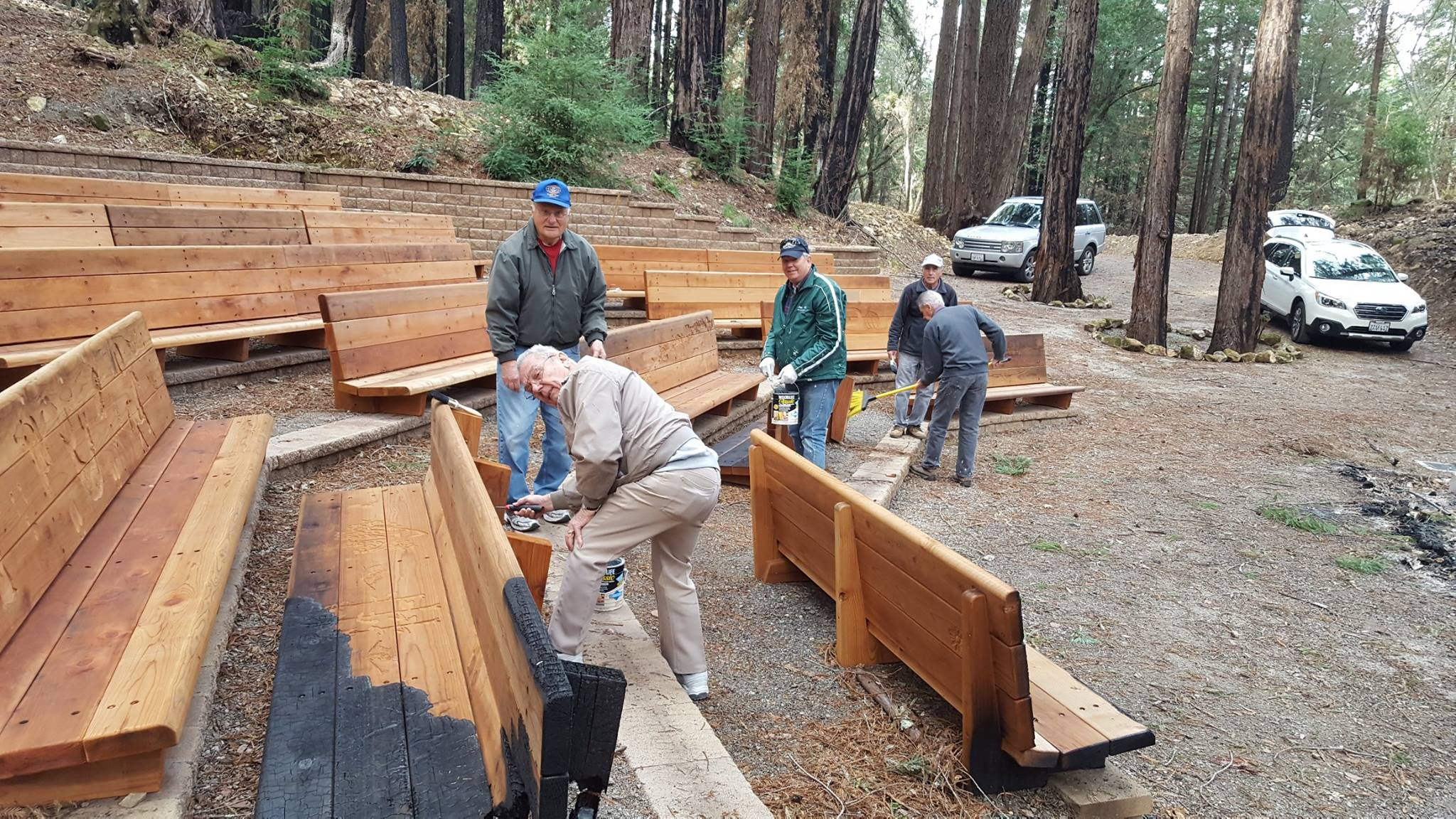 Our friends from the Napa Kiwanis Club put a protective coating on the benches in the Redwood Grove Theater to prevent rot. Some of the benches are charred, a reminder of the October fires in Napa.